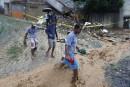 Inondations: Rio en deuil compte ses morts