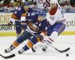 Travis Moen poursuit John Tavares au premier vingt.... | 9 février 2012