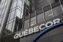 Le profit de Québecor chute de moitié