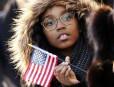 Une spectatrice lors de la parade inaugurale à Washington... | 24 janvier 2013