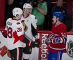 Ryan White (53) du Canadien de Montréal discute avec Matt Kassian (28) et Zack Smith (15). | 3 mai 2013