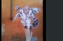 Un graffiti du pape en superman tweeté par le Vatican