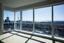 Au-dessus du 55e étage, la construction de la tour va...   5 mai 2014