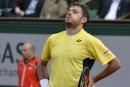 Wawrinka prend la porte, Djokovic et Nadal se baladent