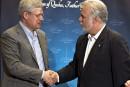 Couillard dit à Harper vouloir signer la Constitution