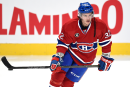 Le Canadien et Brian Flynn en discussion