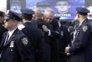 New York: des milliers de personnes aux funérailles d'un policier tué