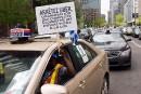 Le système de permis de taxi remis en question au pays