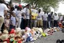 Moment de silence à Ferguson pour la mort de Michael Brown