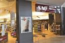 Pas de lobby de la SAQ contre la vente libre de vins du Québec, assure Couillard