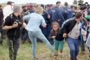 La camérawoman hongroise qui a frappé des migrants s'excuse