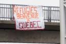 Une banderole accueillante pour les réfugiés à Québec