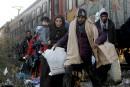 Réfugiés: Couillard rappelle la tradition d'accueil