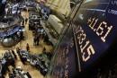 La Bourse de Toronto et le dollar canadien clôturent en baisse