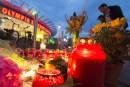 Bougies, fleurs et larmes après la tuerie de Munich