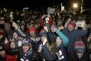 Les partisans des Patriots bravent le froid pour célébrer