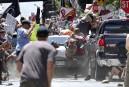 Une voiture a foncé dans un groupe de manifestants qui... | 12 août 2017