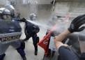 Des policiers repoussent des manifestants pro-immigration.... | 20 août 2017