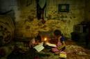 Des enfants palestiniens font leurs devoirs lors d'une coupure de... | 12 septembre 2017