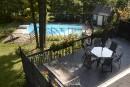 Une terrasse en paliers mène jusqu'à la piscine.... | 27 septembre 2017