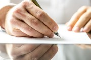 Man writing on a blank paper
