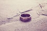 Vintage toned single weeding ring on stone background, conceptua