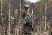 Woman hunter shooting in the forest