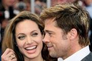 Angelina Jolie et Brad Pitt à Deauville.... (AFP) - image 7.0
