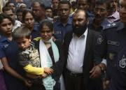 Les propriétaires de l'usine Tazreen,Delwar Hossain et sa... (REUTERS) - image 1.0