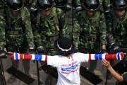 Un tribunal thaïlandais a interdit mercredi au gouvernement... (Photo Wason Wanichakorn, AP) - image 1.0