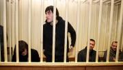 Quatre des cinq accusés... (Photo Alexey SAZONOV, Archives AFP) - image 1.0