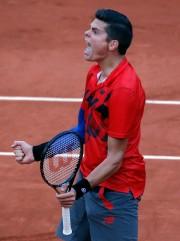 Milos Raonic... (Photo Michel Euler, AP) - image 2.0