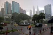 Kuala Lampur, une ville que les touristes aiment... (Photo Mohd Rasfan, AFP) - image 2.0