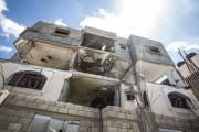 Une maison de Gaza éventrée par les bombardements... (PHOTO OLIVIER PONTBRIAND, LA PRESSE) - image 3.0