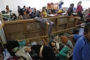 Dans cette photo prise samedi dernier, des déplacés... (Photo: AP) - image 2.0