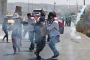 Des manifestants palestiniens ont dénoncé l'offensive israélienne sur... (PHOTO NASSER ISHTAYEH, REUTERS) - image 2.0