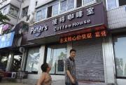 Le couple tient actuellement un café à Dandong.... (Photo Reuters) - image 1.0