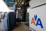 Les frais pour les bagages varient d'une compagnie... (Photo: archives AP) - image 2.0