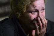 Une femme blessée lors du bombardement qui a... (PHOTO JOHN MACDOUGALL, AFP) - image 3.0