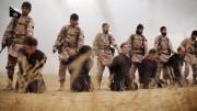 Dans la vidéo des exécutions, les combattants de... (Photo tirée d'une vidéo) - image 1.0