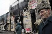 Des commerces du centre-ville de Grozny ont également... (PHOTO MUSA SADULAYEV, AP) - image 1.1