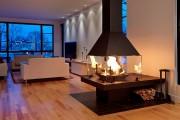 Un foyer multifaces délimite avec chaleur deux zones... (Don-Bar) - image 2.0