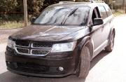 Un Dodge Journey criblé de balles et utilisé... (PHOTO COURTOISIE) - image 1.0