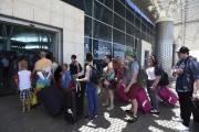Des touristes britanniques s'apprêtaient à quitter la Tunisie,... (PHOTO FETHI BELAID, AFP) - image 2.0