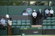 Une minute de silence est observée à Wimbledon... (PHOTO KIRSTY WIGGLESWORTH, AP) - image 2.0