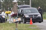 Les corps des deux victimes sont recueillis par... (Photo Patrick Sanfaçon, La Presse) - image 1.0
