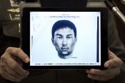 Le deuxième suspect: un homme brun avec une... (PHOTO NICOLAS ASFOURI, AFP) - image 1.0