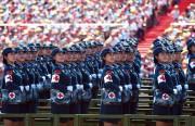 Le président chinois Xi Jinping a salué jeudi... (PHOTO GREG BAKER, AFP) - image 1.0