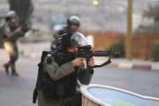 Un adolescent palestinien a été tué lundi par... (PHOTO MOHAMAD TOROKMAN, REUTERS) - image 1.0