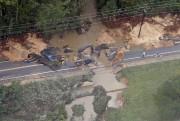 Les inondations record ravageant depuis jeudi l'État de... (PHOTO AP) - image 2.0